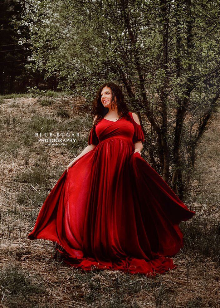 Maternity Photography: pregnant woman in a red maternity gown