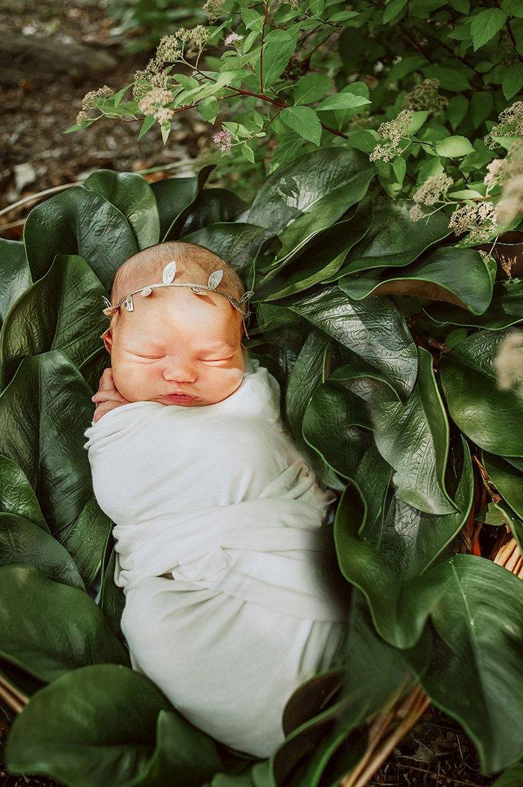 baby wrapped newborn pose